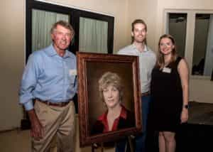 Kris Knab's family stands with her memorial portrait